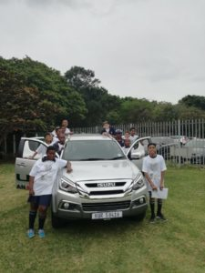 CMH Umhlanga- Kids with a silver Isuzu MUX